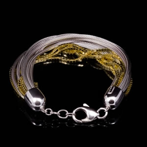 Italian Designer Multichain Bracelet In Gold And Silver