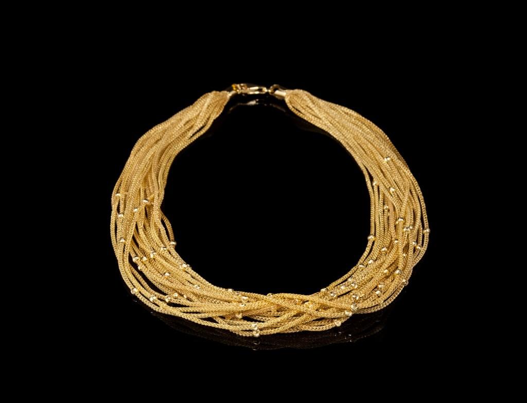 Classique Gold Tuft Necklace